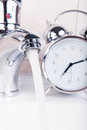 Wasting time and water concept Royalty Free Stock Photo