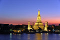 Wat arun bangkok thailand gold lighting after sunset with twilight sky Stock Photo