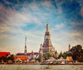 Wat arun bangkok thailand vintage retro hipster style travel image of buddhist temple on chao phraya river with grunge texture Royalty Free Stock Image