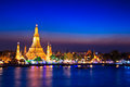 Wat arun in the sunset ratchawararam ratchawaramahawihan or with sky bangkok of thailand Stock Photos
