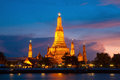 Wat arun the temple of dawn bangkok thailand during sun set on chaophraya river Stock Image