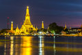 Wat arun twilight view of across chao phraya river during sunset in bangkok thailand Royalty Free Stock Photo