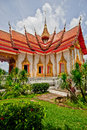 Wat chalong ubosot the sanctuary hall with its steeply pitched gabled roofs chofah ornaments and gilded spire Stock Photography