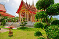 Wat chalong ubosot the sanctuary hall with its steeply pitched gabled roofs chofah ornaments and gilded spire Royalty Free Stock Photography