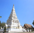 Wat chedi liam white triangle pagoda at ancient buddhist temple at wiang kum kam chiangmai thailand Royalty Free Stock Image
