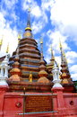 Wat phan tao temple of thailand the beautiful pagoda in blue sky Stock Photo