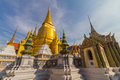 Wat phra kaeo temple of the emerald buddha and the home of the thai king is one bangkok s most famous tourist Stock Photo