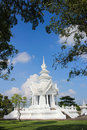 Wat rong khun more well known among foreigners as the white temple is a contemporary unconventional buddhist temple in chiang rai Stock Photo