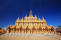 Wat tha sung in uthai thani thailand golden thai pagoda against blue sky at Stock Images
