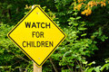 Watch for children sign yellow road Royalty Free Stock Photos