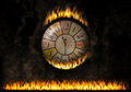 Watch clock fiery the elapsed time concept of burn time urgency a wall caught fire under this a long zone or speed action Royalty Free Stock Photo