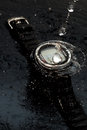 Watch computer for diving in water streams on a black background Royalty Free Stock Photo