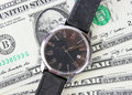 Watch on dollars time is money Stock Photography