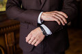 Watch on a man's hand, the fees of the groom, wedding preparation