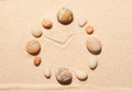 Watch from sea stones on sand summer beach background view above Stock Photos