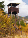 Watch tower in countryside old wooden with mountains background Royalty Free Stock Photos