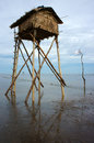 Watch tower on viet nam beach wooden at mekong delta reflect water sea with black sand day Royalty Free Stock Image