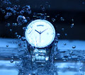 Watch under watershower an artistic shot of water bubbles splash Royalty Free Stock Image
