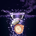 Watch into water d clock falling in the pcs Stock Photography