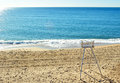 Watchful beach chair in lonely morning Royalty Free Stock Photo