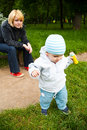 Watching baby in park Stock Photography