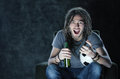 Watching soccer on tv young adult man football television goal Royalty Free Stock Image