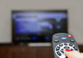 Watching TV and using remote controller Royalty Free Stock Photo