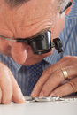 Watchmaker With Magnifying Glasses Royalty Free Stock Image
