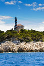 Watchtower on a cliff above the adriatic sea Stock Photos