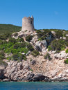 Watchtower gorgeous tower ruins located above the mediterranean bay Stock Photography