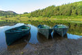 Watendlath lake district england august rowing boats moo moored at tarn in the on Royalty Free Stock Images