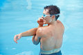 Water aerobics in swimming pool Stock Photo
