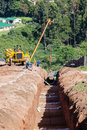 Water aqueduct pipeline trench construction new and installation between reservoirs outside durban south africa Royalty Free Stock Photo