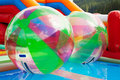 Water ball in open swimming pool walking zorbing Royalty Free Stock Image