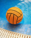 Water ball orange color in swimming poo Royalty Free Stock Image