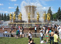 Water battle moscow russia june a large group of teenagers pouring on each other near the fountain called friendship of nations of Royalty Free Stock Image