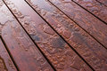 Water beading on freshly sealed deck pooled finished with woodgrain excellent background for illustrating construction or Stock Photos