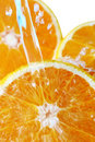 Water beeing poured into a orange Stock Images