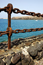 Water boat and sr in lanzarote spain rusty chain yacht coastline summer Stock Images