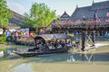 Water boat with tourists floats under the bridge of thailand cou ayudthaya march wooden in countryside on march market locates Royalty Free Stock Photography