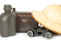 Water bottle camera bag binoculars and safari hat old green vintage reed isolated Stock Image