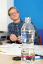 Water bottle healty habits drinking plenty of to prevent dehydration also applies to office work Royalty Free Stock Photo