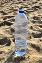 Water bottle on the sand a with beach Royalty Free Stock Image