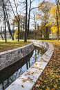 Water canal in autumn or conduit a park houses background Stock Photography