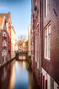 Water canal and houses in Amsterdam Royalty Free Stock Photo