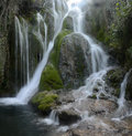 Water cascade stream flowing over rocks covered with moss close to the city of frias in spain Royalty Free Stock Photo