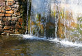 Water cascade in summery landscape Stock Images