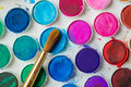 Water color paint box and paint brush close up of Royalty Free Stock Photo