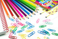 Water colored pencils and paperclips, school concept Royalty Free Stock Photo