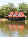 Water cottage lake house small easy with red roof tiles in a public park for rest and relax in bangkok thailand Stock Images
